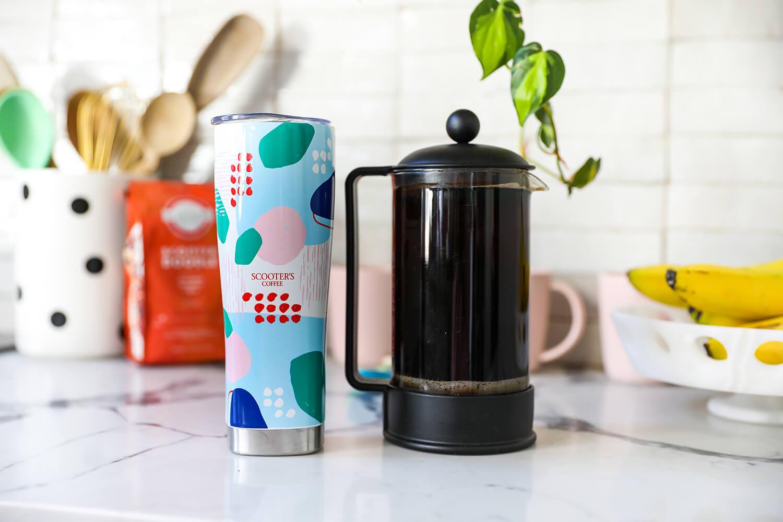 Tumbler next to pot of coffee